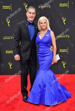 Peewee Piemonte, Julie Michaels. Peewee Piemonte, left, and Julie Michaels arrive at night two of the Television Academy's 2019 Creative Arts Emmy Awards, at the Microsoft Theater in Los Angeles