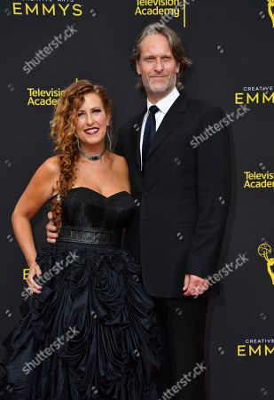 Sherri Berman Laurence, Michael Laurence. Sherri Berman Laurence, left, and Michael Laurence arrive at night two of the Television Academy's 2019 Creative Arts Emmy Awards, at the Microsoft Theater in Los Angeles