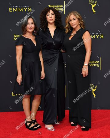 Amy Schatz, Sara Rodriguez, Melody Herzfeld. Amy Schatz, from left, Sara Rodriguez and Melody Herzfeld arrive at night two of the Television Academy's 2019 Creative Arts Emmy Awards, at the Microsoft Theater in Los Angeles