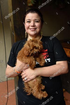 News Anchor for CNN Ana Navarro with her dog Chacha.