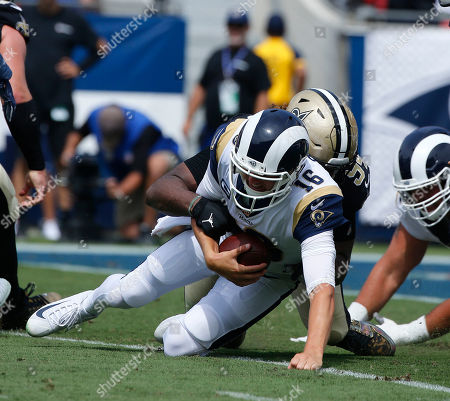 Los Angeles Rams quarterback Jared Goff (16) is sacked by New Orleans Saints defensive end Cameron Jordan (94) during the NFL game between the Los Angeles Rams and the New Orleans Saints at the Los Angeles Coliseum in Los Angeles, California