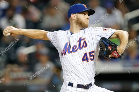 Stock Image of Jeff Wheeler. New York Mets starting pitcher Zack Wheeler (45) winds up during the first inning of a baseball game against the Los Angeles Dodgers, in New York