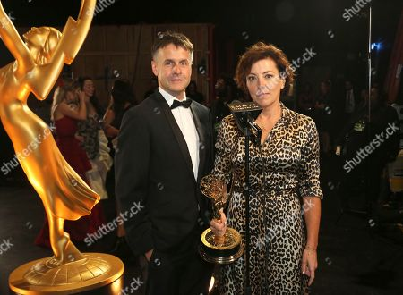 """Robert Sterne, Nina Gold. Robert Sterne, left, and Nina Gold backstage with the award for outstanding casting for a drama series for """"Game of Thrones,"""" night two of the Television Academy's 2019 Creative Arts Emmy Awards, at the Microsoft Theater in Los Angeles"""