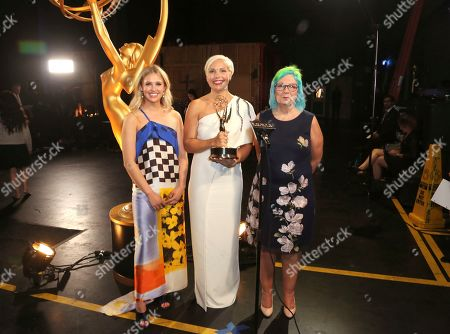 "Charlotte Svenson, Jennifer Rogien, Melissa Stanton. Charlotte Svenson, from left, Jennifer Rogien, and Melissa Stanton with their award for outstanding contemporary costumes for ""Russian Doll"" during night two of the Television Academy's 2019 Creative Arts Emmy Awards, at the Microsoft Theater in Los Angeles"