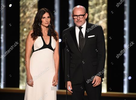 Michaela Watkins, Rob Corddry. Michaela Watkins, left and Rob Corddry present the award for outstanding cinematography for a limited series or movie on night two of the Television Academy's 2019 Creative Arts Emmy Awards, at the Microsoft Theater in Los Angeles