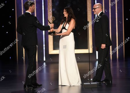 "Michaela Watkins, Rob Corddry, Jakob Ihre. Michaela Watkins, center left and Rob Corddry present Jakob Ihre the award for outstanding cinematography for a limited series or movie for ""Chernobyl"" on night two of the Television Academy's 2019 Creative Arts Emmy Awards, at the Microsoft Theater in Los Angeles"