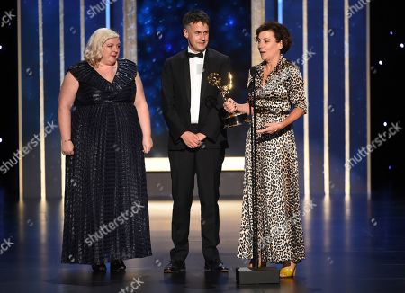 """Carla Stronge, Robert Sterne, Nina Gold. Carla Stronge, from left, Robert Sterne and Nina Gold accept the award for outstanding casting for a drama series for """"Game of Thrones"""" on night two of the Television Academy's 2019 Creative Arts Emmy Awards, at the Microsoft Theater in Los Angeles"""
