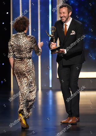 """Chris O'Dowd, Nina Gold. Chris O'Dowd, right, presents Nina Gold of """"Game of Thrones"""" the award for outstanding casting for a drama series on night two of the Television Academy's 2019 Creative Arts Emmy Awards, at the Microsoft Theater in Los Angeles"""