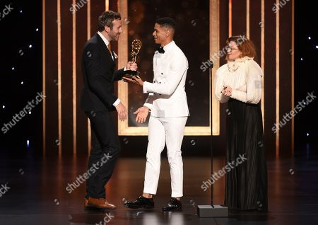 Chris O'Dowd, Natasha Lyonne, Charlie Barnett. Chris O'Dowd, from left, accepts the award from Charlie Barnett and Natasha Lyonne, for outstanding actor in a short form comedy or drama series for State Of The Union on night two of the Television Academy's 2019 Creative Arts Emmy Awards, at the Microsoft Theater in Los Angeles