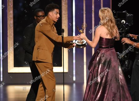 """Stock Photo of Shameik Moore, Marcus Scribner, Shauna Duggins. Shameik Moore, left, and Marcus Scribner present the award to Shauna Duggins of """"Glow"""" for Outstanding Stunt Coordination for a Comedy Series or Variety Program on night two of the Television Academy's 2019 Creative Arts Emmy Awards, at the Microsoft Theater in Los Angeles"""