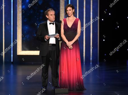 Stock Image of Maggie Siff, Peter MacNicol. Peter MacNicol, left, and Maggie Siff present the award for Outstanding Cinematography for a Single-Camera Series (One Hour) on night two of the Television Academy's 2019 Creative Arts Emmy Awards, at the Microsoft Theater in Los Angeles