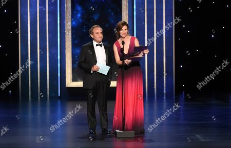 Peter MacNicol, Maggie Siff. Peter MacNicol, left, and Maggie Siff present the award for Outstanding Cinematography for a Multi-Camera Series on night two of the Television Academy's 2019 Creative Arts Emmy Awards, at the Microsoft Theater in Los Angeles