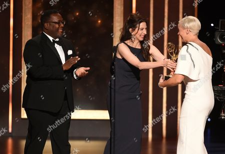 Wendell Pierce, Marin Hinkle, Jennifer Rogien. Wendell Pierce, left, and Marin Hinkle present Jennifer Rogien with the award for outstanding contemporary costumes on night two of the Television Academy's 2019 Creative Arts Emmy Awards, at the Microsoft Theater in Los Angeles