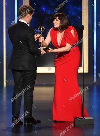 """Rachel Bloom, Michael Bricker. EXCLUSIVE - Rachel Bloom, right, presents Michael Bricker with the award for Outstanding Production Design For A Narrative Program (Half-Hour) for """"Russian Doll - Nothing in This World Is Easy"""" on night two of the Television Academy's 2019 Creative Arts Emmy Awards, at the Microsoft Theater in Los Angeles"""