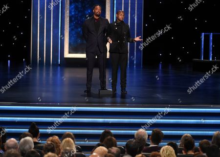 Tommy Davidson, Shawn Wayans. Shawn Wayans, left, Tommy Davidson present the award for Outstanding Guest Actress in a Drama Series on night two of the Television Academy's 2019 Creative Arts Emmy Awards, at the Microsoft Theater in Los Angeles