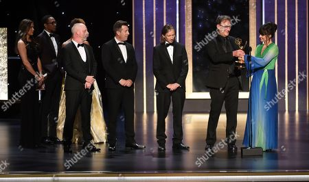 """Danny Crowley, from left, Simon Kerr, Ronan Hill, Mathew Waters, and Onnalee Blank from """"Game of Thrones"""" accept the award for outstanding sound mixing for a comedy series or drama series for """"The Long Night"""" on night two of the Television Academy's 2019 Creative Arts Emmy Awards, at the Microsoft Theater in Los Angeles"""