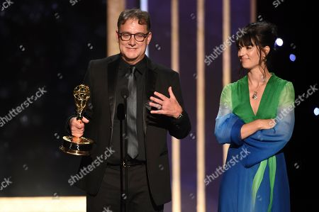"""Stock Picture of Mathew Waters, left, and Onnalee Blank from """"Game of Thrones"""" accept the award for outstanding sound mixing for a comedy series or drama series for """"The Long Night"""" on night two of the Television Academy's 2019 Creative Arts Emmy Awards, at the Microsoft Theater in Los Angeles"""