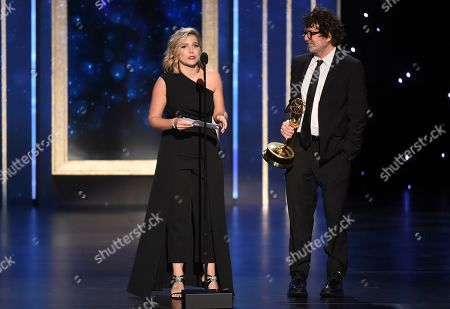 """Ashley Ingram, left, and Billy Hopkins accept the award for outstanding casting for a limited series, movie or special for """"When They See Us"""" on night two of the Television Academy's 2019 Creative Arts Emmy Awards, at the Microsoft Theater in Los Angeles"""