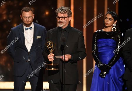 "Rastam Hasanov, from left, Angus Wall, and Shahana Khan accept the award from Charlie Barnett for outstanding main title design for ""Game of Thrones"" on night two of the Television Academy's 2019 Creative Arts Emmy Awards, at the Microsoft Theater in Los Angeles"