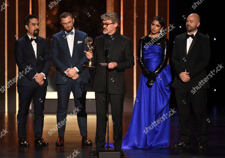 "Kirk H. Shintani, from left, Rastam Hasanov, Angus Wall, Shahana Khan, and Ian Ruhfass accept the award from Charlie Barnett for outstanding main title design for ""Game of Thrones"" on night two of the Television Academy's 2019 Creative Arts Emmy Awards, at the Microsoft Theater in Los Angeles"