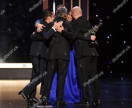 "Kirk H. Shintani, Rastam Hasanov, Angus Wall, Shahana Khan, and Ian Ruhfass embrace while accepting the award from Charlie Barnett for outstanding main title design for ""Game of Thrones"" on night two of the Television Academy's 2019 Creative Arts Emmy Awards, at the Microsoft Theater in Los Angeles"