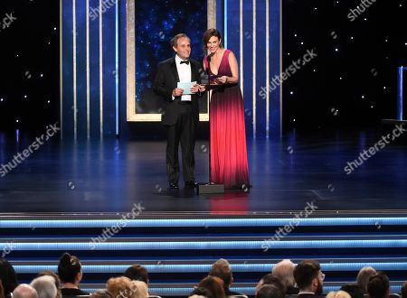 Maggie Siff, Peter MacNicol. Peter MacNicol, left, and Maggie Siff present the award for Outstanding Cinematography for a Single-Camera Series (One Hour) on night two of the Television Academy's 2019 Creative Arts Emmy Awards, at the Microsoft Theater in Los Angeles