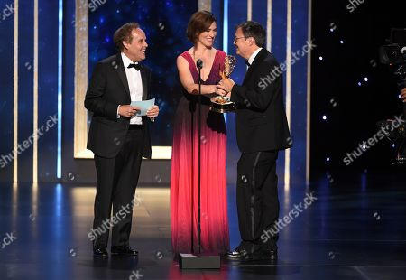Stock Picture of M. David Mullen, Peter MacNicol, Maggie Siff. Peter MacNicol, left, and Maggie Siff present the award to M. David Mullen for outstanding cinematography for a single-camera series for The Marvelous Mrs. Maisel on night two of the Television Academy's 2019 Creative Arts Emmy Awards, at the Microsoft Theater in Los Angeles