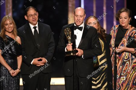 "Stock Picture of Brown Johnson, Benjamin Lehmann Ken Scarborough, Mindy Fila, Karyn Leibovich, Stephanie Longardo. The team from ""When You Wish Upon A Pickle; A Sesame Street Special"" accept the award for Outstanding Children's Program on night two of the Television Academy's 2019 Creative Arts Emmy Awards, at the Microsoft Theater in Los Angeles"