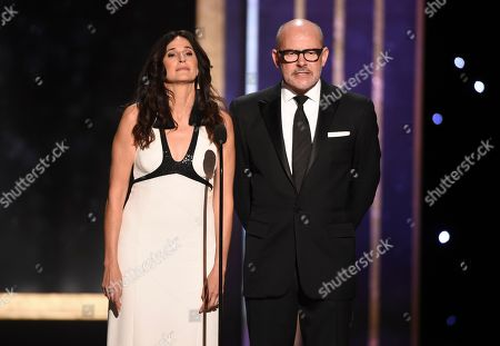Michaela Watkins, Rob Corddry. Michaela Watkins, left, and Rob Corddry present the award for outstanding cinematography for a single camera comedy series on night two of the Television Academy's 2019 Creative Arts Emmy Awards, at the Microsoft Theater in Los Angeles