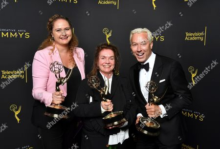 """Marina Reti, Donna Zakowska, Tim McKelvey. Marina Reti, from left, Donna Zakowska, and Tim McKelvey pose for a portrait with the award for outstanding period costumes for """"The Marvelous Mrs. Maisel"""" on night two of the Television Academy's 2019 Creative Arts Emmy Awards, at the Microsoft Theater in Los Angeles"""