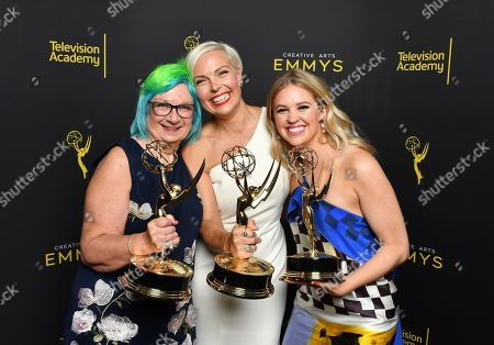 "Melissa Stanton, Jennifer Rogien, Charlotte Svenson. Melissa Stanton, from left, Jennifer Rogien, and Charlotte Svenson pose for portrait with the award for outstanding contemporary costumes for ""Russian Doll"" on night two of the Television Academy's 2019 Creative Arts Emmy Awards, at the Microsoft Theater in Los Angeles"