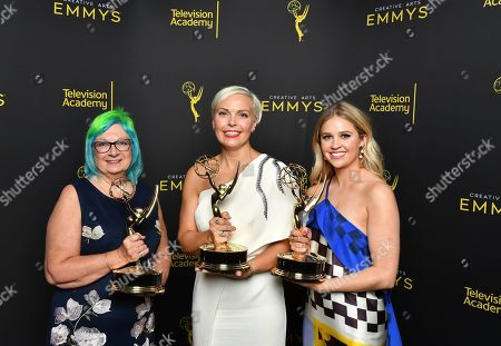 "Stock Image of Melissa Stanton, Jennifer Rogien, Charlotte Svenson. Melissa Stanton, from left, Jennifer Rogien, and Charlotte Svenson pose for portrait with the award for outstanding contemporary costumes for ""Russian Doll"" on night two of the Television Academy's 2019 Creative Arts Emmy Awards, at the Microsoft Theater in Los Angeles"