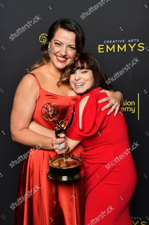 """Kathryn Burns, Rachel Bloom. Kathryn Burns, left, with the award for outstanding choreography for scripted programming for """"Crazy Ex-Girlfriend"""", embraces Rachel Bloom on night two of the Television Academy's 2019 Creative Arts Emmy Awards, at the Microsoft Theater in Los Angeles"""