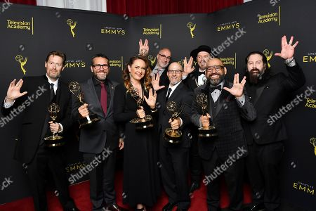 "Chris Bridges, James Mackinnon, Nicola Bendrey, Neville Page, Mike O'Brien, Rocky Faulkner, Hugo Villasenor, Glenn Hetrick. Chris Bridges, from left, James Mackinnon, Nicola Bendrey, Neville Page, Mike O'Brien, Rocky Faulkner, Hugo Villasenor and Glenn Hetrick accept the award for outstanding prosthetic makeup for a series, limited series, movie or special for ""Star Trek: Discovery - If Memory Serves"" on night two of the Television Academy's 2019 Creative Arts Emmy Awards, at the Microsoft Theater in Los Angeles"