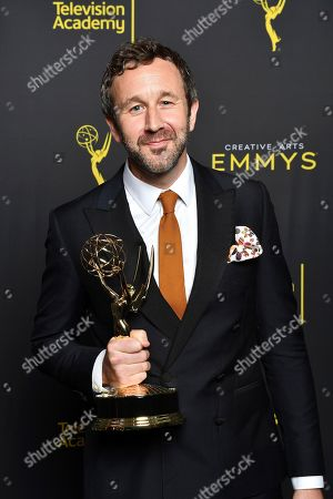 "Chris O'Dowd poses for a portrait in the press room with the award for outstanding actor in a short form comedy or drama series for ""State Of The Union"" on night two of the Television Academy's 2019 Creative Arts Emmy Awards, at the Microsoft Theater in Los Angeles"
