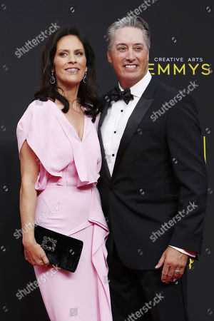 Annabeth Gish (L) and stunt performer Wade Allen (R) arrive for the 2019 Creative Arts Emmy Awards at the Microsoft Theater in Los Angeles, California, USA, 15 September 2019. The Creative Arts Emmy Awards honor excellence in Television technical categories such as makeup, casting direction, costume design, editing and cinematography. The 71st Primetime Emmy Awards Ceremony will take place on 22 September 2019.