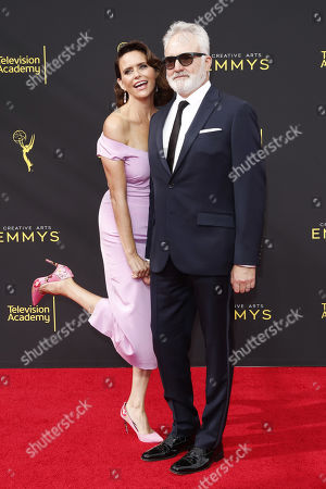 Bradley Whitford (R) and his wife US actress Amy Landecker (L) arrive for the 2019 Creative Arts Emmy Awards at the Microsoft Theater in Los Angeles, California, USA, 15 September 2019. The Creative Arts Emmy Awards honor excellence in Television technical categories such as makeup, casting direction, costume design, editing and cinematography. The 71st Primetime Emmy Awards Ceremony will take place on 22 September 2019.
