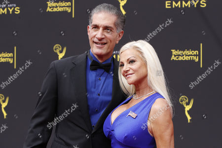 Stunt actor Julie Michaels (R) and her husband Peewee Piemonte (L) arrive for the 2019 Creative Arts Emmy Awards at the Microsoft Theater in Los Angeles, California, USA, 15 September 2019. The Creative Arts Emmy Awards honor excellence in Television technical categories such as makeup, casting direction, costume design, editing and cinematography. The 71st Primetime Emmy Awards Ceremony will take place on 22 September 2019.