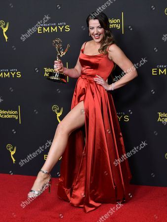 "Kathryn Burns poses in the press room with the award for outstanding choreography for scripted programing for ""Crazy Ex-Girlfriend"" on night two of the Creative Arts Emmy Awards, at the Microsoft Theater in Los Angeles"