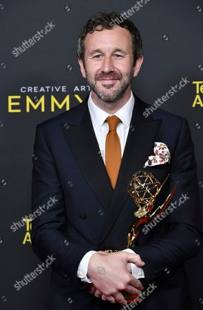 "Chris O'Dowd poses in the press room with the award for outstanding actor in a short form comedy or drama series for ""State Of The Union"" poses in the press room on night two of the Creative Arts Emmy Awards, at the Microsoft Theater in Los Angeles"