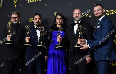 "Stock Image of Angus Wall, Kirk H. Shintani, Shahana Khan, Ian Ruhfass, Rustam Hasanov. Angus Wall, from left, Kirk H. Shintani, Shahana Khan, Ian Ruhfass, Rustam Hasanov pose in the press room with their awards for outstanding main title design for ""Game of Thrones"" on night two of the Creative Arts Emmy Awards, at the Microsoft Theater in Los Angeles"
