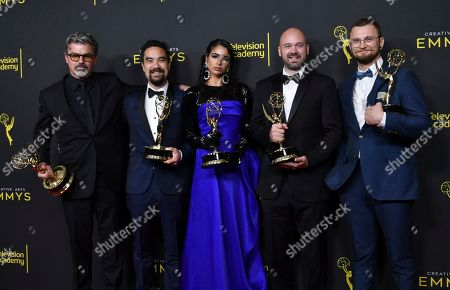 "Angus Wall, Kirk H. Shintani, Shahana Khan, Ian Ruhfass, Rustam Hasanov. Angus Wall, from left, Kirk H. Shintani, Shahana Khan, Ian Ruhfass, Rustam Hasanov pose in the press room with their awards for outstanding main title design for ""Game of Thrones"" on night two of the Creative Arts Emmy Awards, at the Microsoft Theater in Los Angeles"