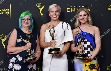 "Melissa Stanton, Jennifer Rogien, Charlotte Svenson. Melissa Stanton, from left, Jennifer Rogien, and Charlotte Svenson pose in the press room with their awards for outstanding contemporary costumes for ""Russian Doll"" on night two of the Creative Arts Emmy Awards, at the Microsoft Theater in Los Angeles"