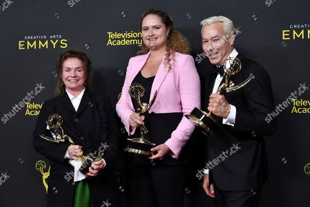 """Donna Zakowska, Marina Reti, Tim McKelvey. Donna Zakowska, from left, Marina Reti, and Tim McKelvey poses in the press room with their awards for outstanding period costumes for """"The Marvelous Mrs. Maisel"""" on night two of the Creative Arts Emmy Awards, at the Microsoft Theater in Los Angeles"""