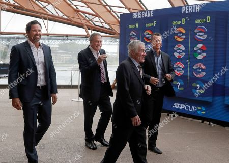 Stock Photo of Pat Rafter, John Newcombe, Ken Rosewall, Lleyton Hewitt. Australian former World number 1 tennis players, Pat Rafter, left, John Newcombe, Ken Rosewall, second right, and Lleyton Hewitt, right, walk past a board showing the draw for the ATP Cup 2020 in Sydney, . Eight teams from the six-day group stage will advance to the knockout rounds, which will continue in Sydney until Jan. 12