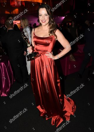 "Kathryn Burns poses with the award for outstanding choreography for scripted programming for ""Crazy Ex-Girlfriend,"" at the Governors Ball during night two of the Television Academy's 2019 Creative Arts Emmy Awards, at the Microsoft Theater in Los Angeles"