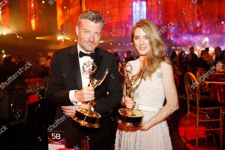 """Stock Picture of Charlie Booker, Annabel Jones. Charlie Booker, left, and Annabel Jones, winners of the award for outstanding creative achievement in interactive media within a scripted program for """"Black Mirror"""" attend the Governors Ball during night two of the Television Academy's 2019 Creative Arts Emmy Awards, at the Microsoft Theater in Los Angeles"""