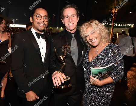 """Stock Picture of Reza Harahap, Steve Kullback, Meryl Matthews. Reza Harahap, left, and Meryl Matthews, right, pose with Steve Kullback, winner of the award for outstanding special visual effects """"Game of Thrones,"""" at the Governors Ball during night two of the Television Academy's 2019 Creative Arts Emmy Awards, at the Microsoft Theater in Los Angeles"""