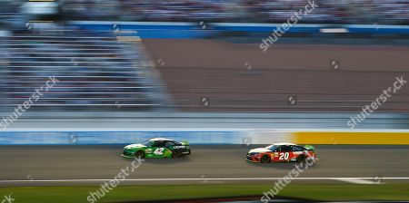 Kyle Larson (42) and Erik Jones (20) drive during a NASCAR Cup Series auto race at the Las Vegas Motor Speedway on