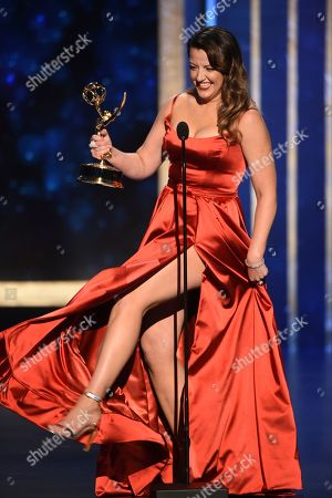"Kathryn Burns accepts the award for outstanding choreography for scripted programming for ""Crazy Ex-Girlfriend,"" on night two of the Television Academy's 2019 Creative Arts Emmy Awards, at the Microsoft Theater in Los Angeles"